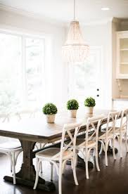 White cross back dining chairs in farmhouse room 14 Affordable Cross-Back Dining Chairs