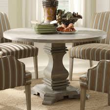 single base rustic round dining table in grey finished feat grey fabric upholstery arms dining chairs