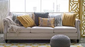 Couch pillow ideas Brown Couch Color Blocking Your Couch Hayneedle Ways To Take Neutral Sofa From Blah To Beautiful Hayneedle