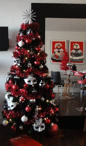 Red And Black Christmas Tree With White And Red Baubles Completed By Silver  Mask On The