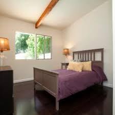 dark wood floor bedroom. Modren Floor White Bedroom With Dark Wood Floors Inside Floor I