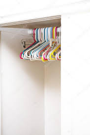 empty closet with hangers. Colorful Hangers In Empty White Closet \u2014 Photo By Logoboom With A