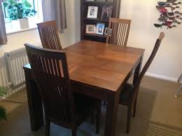 solid wood dining table and 4 high back chairs modern design dark brown