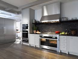 black and stainless kitchen appealing kitchen design ideas with dark wooden flooring and stainless steel range hood plus bertazzoni range also black tile backspalsh