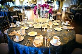round table decorations leafy cylinder vase centerpieces