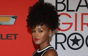 the pop singer janelle monae was photographed last evening in los angeles she was dressed down and about makeup well there s no makeup