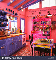 brightly painted furniture. Brightly Painted Multicoloured Table In Bright Pink Kitchen With Vibrant Blue Units And Dresser Flooring Furniture T