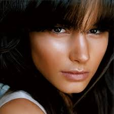tinted moisturizers with luminescent particles or lightweight liquid foundations are best for lined skin unlike