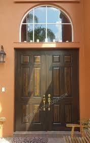 front entry doors faux wood grain painted in a dark walnut faux wood