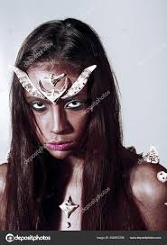 fantasy style makeup ideas concept woman with horns and thorns fantasy creature diabolic appearance mystic fairy tail character