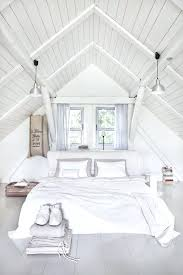 Attic Bedroom Ideas All White Bedroom Beneath The Vaulted Ceiling ...