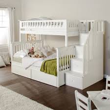 white wooden bunk bed having white wooden stair and drawers also ...