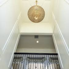 foyer with gold sphere chandelier