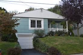 i was wondering about digging a flat section of drive from the road which would go to a garage dug out underneath the house sort of like this