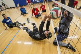 invictus games recovering service members participate in volleyball training