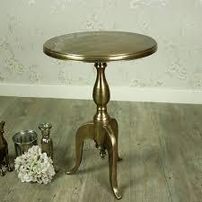 gold round metal pedestal side table
