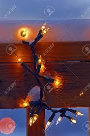How To Hang Christmas Lights On A Deck Closeup Of Christmas Lights Hanging On Deck Railing