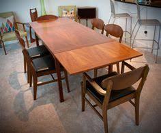 items similar to gorgeous mid century modern danish extendable teak dining table on etsy