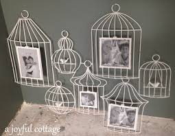 on the website the picture frames hold bird images which i thought were a permanent feature of the wall art i m a little disappointed that the actual