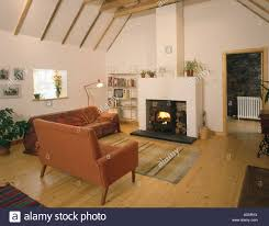 Terracotta Living Room Terracotta Sofas And Fireplace In Barn Conversion Livingroom With