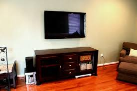 flat screen tv wall mounts on the wooden cabinet saomc co