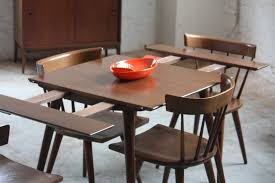 small brown wooden expandable dining table and chairs
