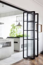 glass bi fold interior doors between kitchen and dining room