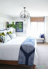 guest bedroom with woven shades ribbon trimmed ds white bedding navy blue paisley throw doxology canvas