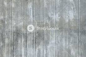grey concrete wall with parallel traces from rubbed finish grey concrete wall with parallel traces from