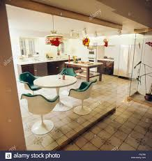 tulip table and chairs. Eero Saarinen Tulip Table And Chairs In Seventies Kitchen With Glass Wall Divider