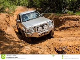 Four-wheel Drive Vehicle Toyota Hilux Is Doing Off-road. Editorial ...