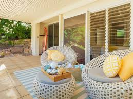 apartment decks outdoor rug for small patio with seafoam blue striped rug under woven bubble furniture