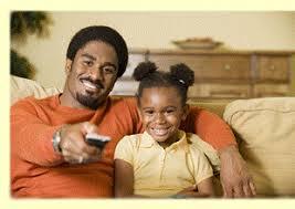 black kids watching tv. father and daughter watching tv black kids