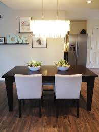 wood tile flooring with mid century dining chairs and exciting capiz chandelier plus photo collage ideas