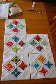Cathedral Window Quilt Blocks - I like the way these are arranged ... & Cathedral Window Quilt Blocks - I like the way these are arranged in groups  off four Adamdwight.com