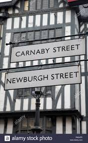 Signs By Design Newburgh In Carnaby And Newburgh Street Signs London England Uk Stock