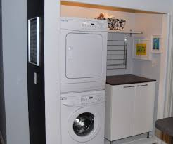 laundry furniture. Saving Small Spaces Laundry Room Design Using Stacked Washer Dryer And Wood Wall Mounted Overhead Shelving Units Over Cabinet With Stainless Steel Legs Furniture T