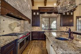 Perfect Tuscan Kitchen With Rustic Brick Walls And Azurite Granite Countertops