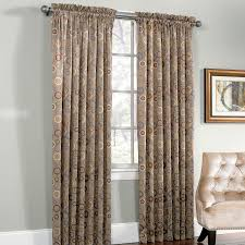 rod pocket decorative room darkening curtains with cozy beige armchair and white baseboard