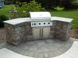 curved stone prefab kitchen island with gray concrete countertop and outdoor bbq island ideas