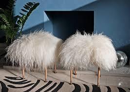 diy sheepskin rug carpet stool tutorial zebra carpet blue walls fireplace ideas room ideas faux