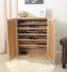 Shoe Storage Solutions Brown Wooden Shoe Rack With Sloping Racks And Double Doors On The