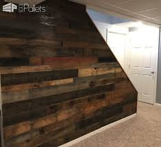 pallet wood walls can turn non functional walls into focal pieces for a v