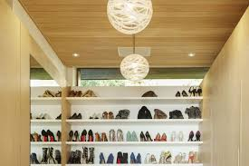 closet lighting. Walk-in Closet With Shoes On Shelves Lighting The Spruce