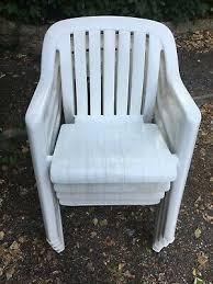 4 white plastic stackable garden chairs