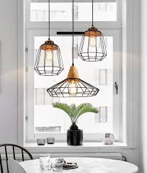 bedroom ceiling lighting. sangkar metal cage pendant light with wood base scandinavian styling ceiling bedroom lighting