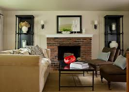 brick fireplace living room traditional with black mirror white fireplace ledge