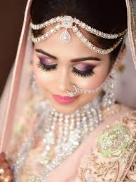 bridal eye makeup with purple glitter and pink lips