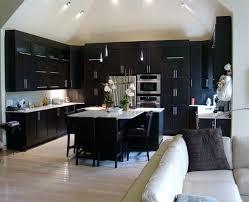 dark cabinets light floors kitchen brass