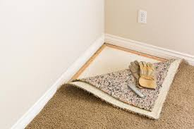 carpet removal tack and padding pulled back to remove